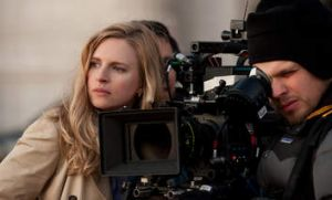 Marling watches filming.