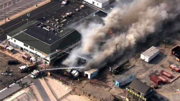 Firefighters battle a raging fire on boardwalk in Seaside Heights, New Jersey.