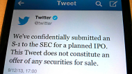 A tweet from Twitter Inc. announcing its initial public offering is shown in this photo illustration in Toronto, ...
