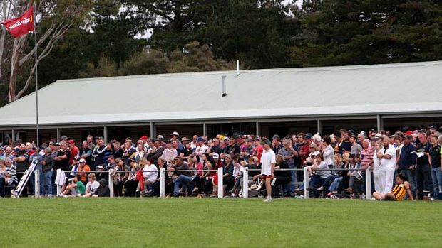 Field of dreams: The crowd lines the fence on grand final day at Mininera oval.