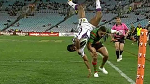 Melbourne's Sisa Waqa falls awkwardly after contact with Dylan Farrell.