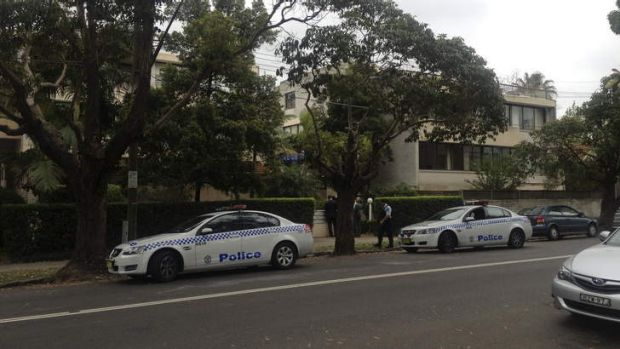 Mystery: Detectives talk to residents of Watson Street in Neutral Bay.