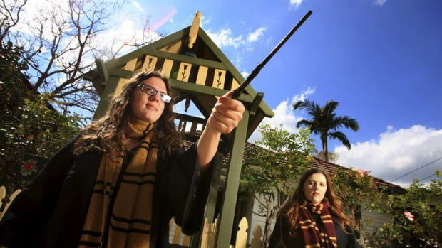 It's wizard: Organiser of Sydney Muggles United, Cassie Watson, left, and sister Alex.