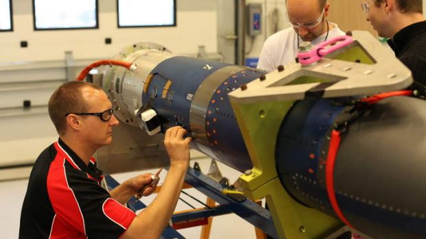 The University of Queensland Scramspace team reparing the payload for launch.
