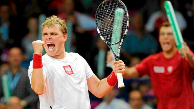 Poland's Marcin Matkowski celebrates winning the doubles rubber.
