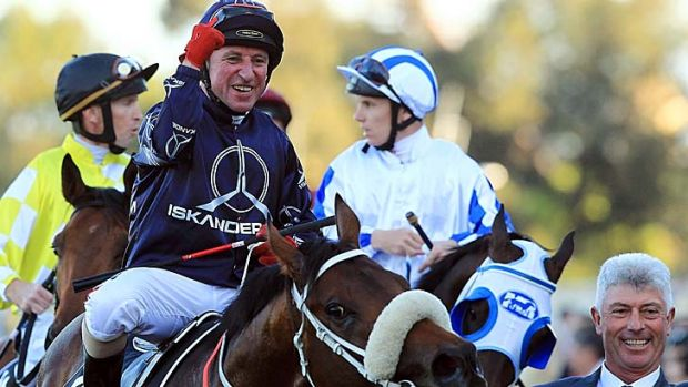 Winners are grinners: Jim Cassidy celebrates his win aboard Zoustar at Rosehill on Saturday.