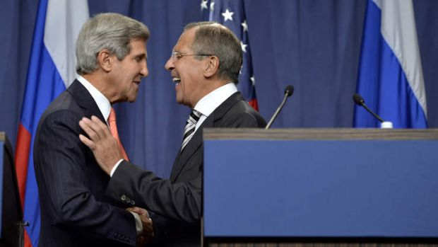 US Secretary of State John Kerry, left, shakes hands with Russian Foreign Minister Sergei Lavrov in Geneva. Russia ...