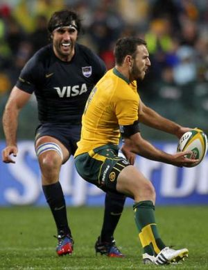Argentine captain Juan Martin Fernandez Lobbe moves on Australian scrum-half Nic White in Perth on Saturday.
