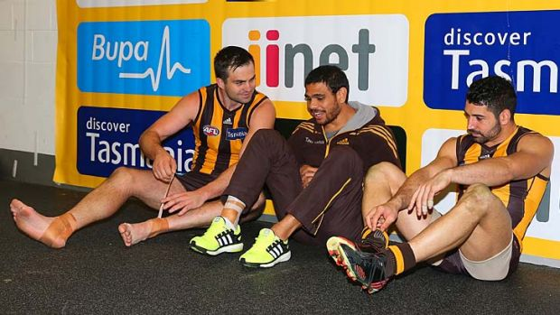 Brian Lake, Cyril Rioli and Brent Guerra after the qualifying final win over Sydney.
