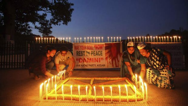 Offering: Indians light candles to mark the verdict after a judge pronounced death sentences for four men convicted in ...