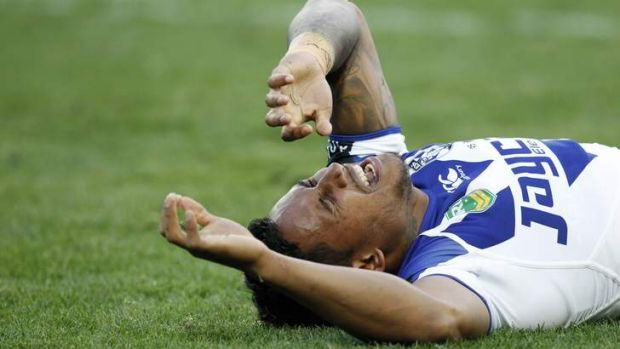 Heard a 'crack': Ben Barba writhes in pain after injuring his ankle during the second half of the elimination final ...
