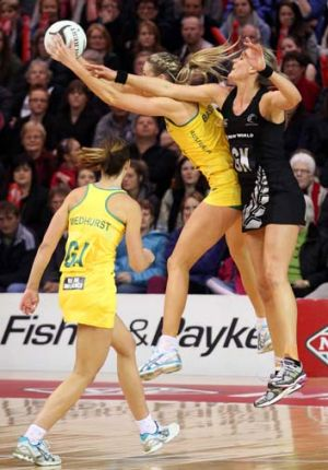 Leana de Bruin of New Zealand and Caitlin Bassett of Australia compete for the ball during game one of the Constellation ...