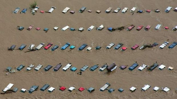 An aerial view of vehicles submerged in flood waters along the South Platte River near Greenley, Colorado.
