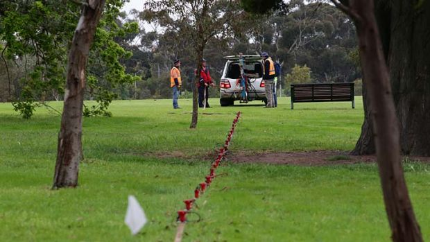 Surveyors in the part of Royal Park where the east-west link exit will be.