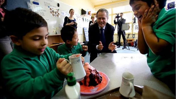 Bill Shorten MP watches a volcano experiment on a visit to the Western Autistic School in Niddrie, Melbourne.