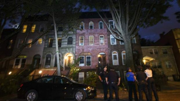 Police officers  outside the home of Cathleen Alexis, mother of Aaron Alexis, in New York.