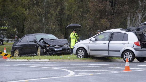 A fatal motor vehicle accident on the corner of Streeton Drive and Namatjira Drive, Weston, near Cooleman Court shopping ...