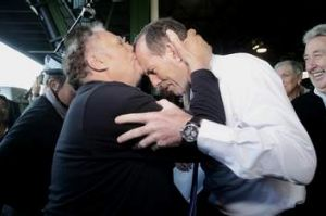 Nino Barbaro kneels before Tony Abbott before rising to kiss his forehead, during a visit to the Sydney Markets.