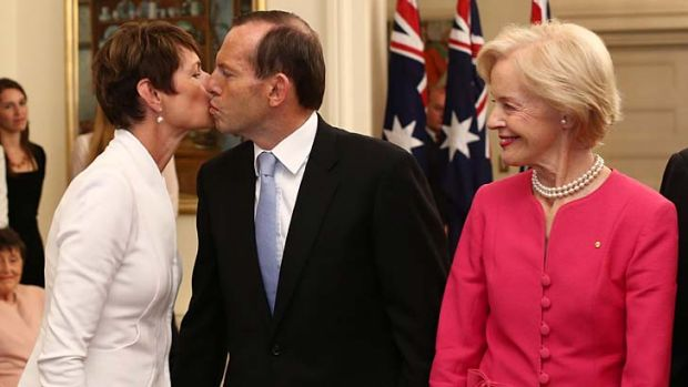 Tony Abbott kisses his wife Margie after he was sworn  in as Australia's 28th Prime Minister by Governor-General Quentin ...
