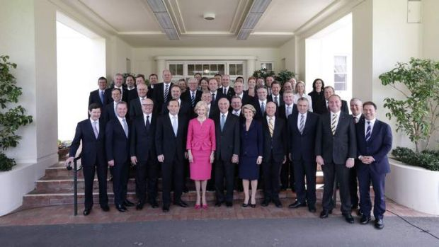 Governor-General Quentin Bryce poses for photos with Prime Minister Tony Abbott and his new ministry at Government House ...