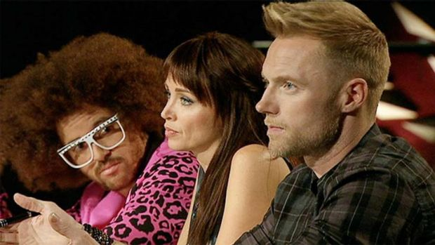 <i>The X Factor</i> judges Ronan Keating, far right, and Redfoo, far left, don't see eye to eye about mentoring styles.