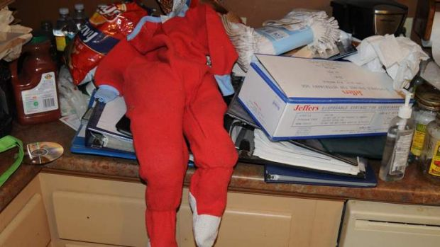 A set of child's pyjamas and a box of syringes are shown in the Massachusetts home of would-be killer and cannibal ...