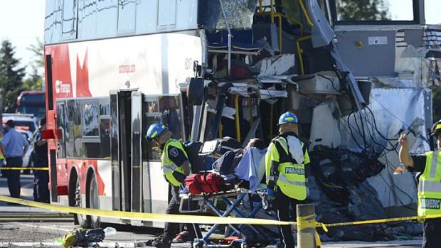 Ottawa: A passenger is taken to an ambulance following the Via Rail train and city bus collision.
