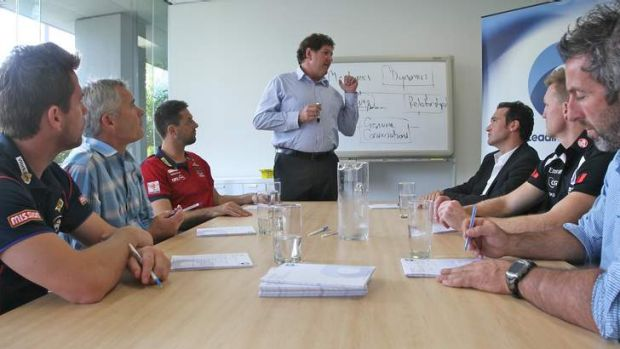 Talk time: Ray McLean from Leading Teams conducts a session with, seated from left, Shannon Grant (Western Bulldogs ...