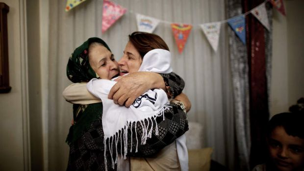 Nasrin Sotoudeh and her mother-in-law embrace in Tehran. Ms Sotoudeh had just been released after a three-year internment.