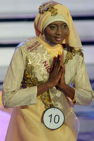 Modest win: Obabiyi Aishah Ajibola from Nigeria is crowned in Jakarta on Wednesday.