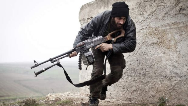 War within a war ... In this file photo, a Free Syrian Army fighter takes cover during fighting with the Syrian Army in ...