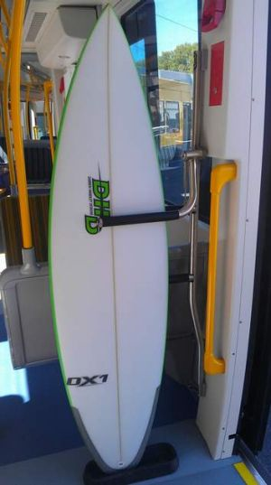 A surf board track being used on one of the new Gold Coast trams.