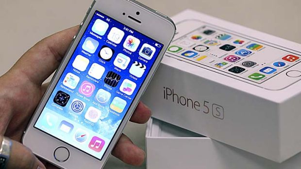 Apple set a new record for iPhones sales in the December quarter but still fell short of analyst expectations.