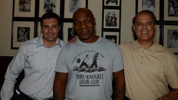 Aaron Gomes with Mike Tyson and his Mob-fighting dad Dennis.