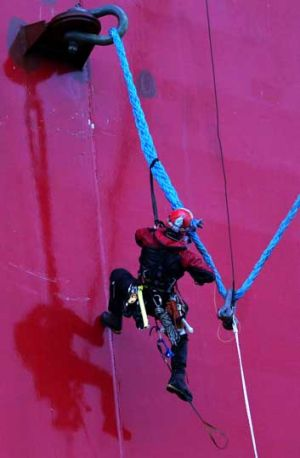A Greenpeace activist climb up the Prirazlomnaya Arctic oil platform.