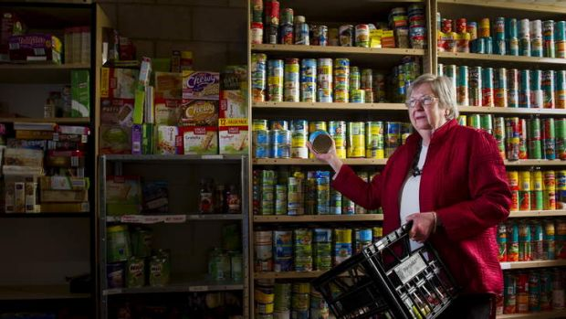 Sue Jordan of St John's Care in one of their grocery storage rooms.