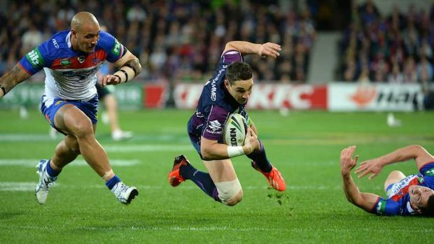 Floored: Billy Slater is brought down.
