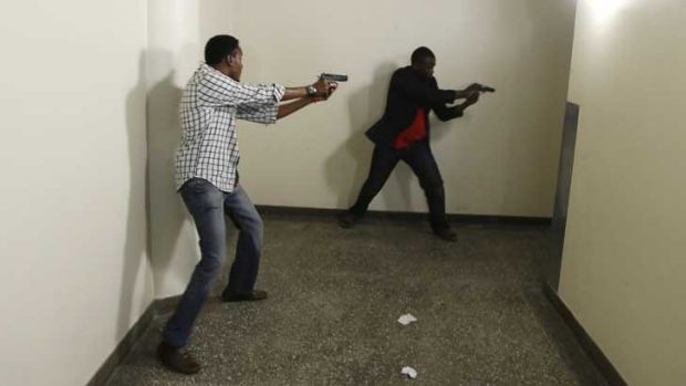Kenyan police search the Westgate mall in Nairobi for the gunmen.
