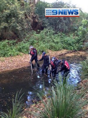 Police divers search creeks near Cedar Pocket Road where the man's body was found.