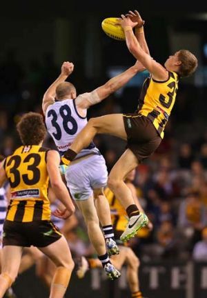 Jed Anderson of the Box Hill Hawks marks over the top of Jackson Sheringham of the Cats during the VFL grand final match ...