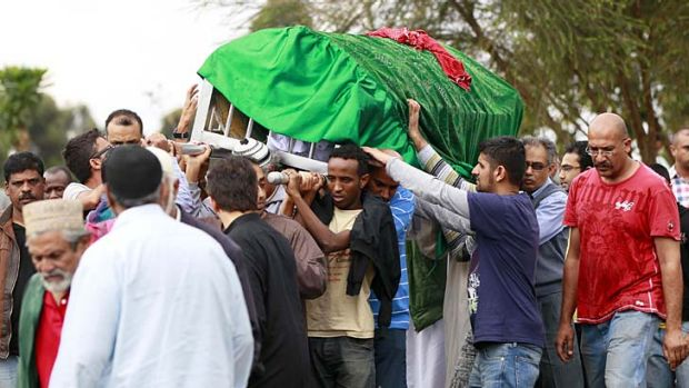 Relatives and Muslim faithful carry the slain body of Rehmad Mehbub, 18, who was killed in a crossfire between armed men ...