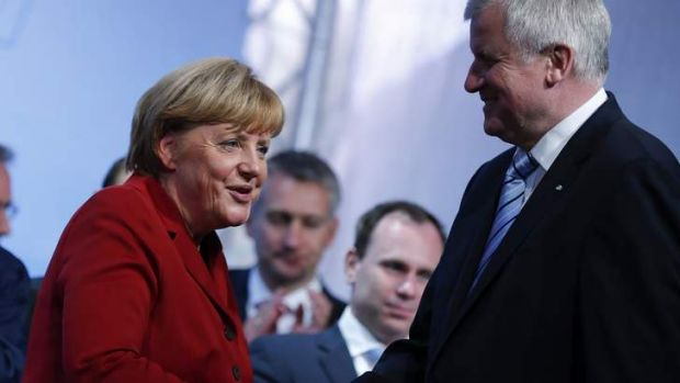 Unifier: German Chancellor Angela Merkel on the campaign trail with Bavarian state Premier Horst Seehofer.