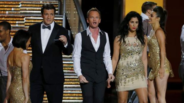 Not necessarily a crowd-pleaser ... (from left) Nathan Fillion, Neil Patrick Harris and Sarah Silverman perform a ...