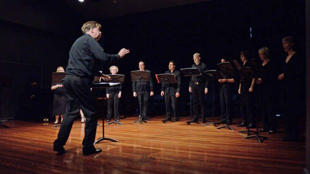 Nicholas Smith conducting Coro in <em>The Yellow River Project</em>.
