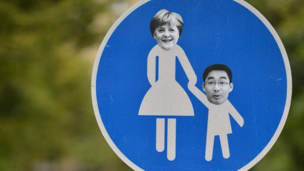 Portraits of Angela Merkel and Free Democrats leader Philipp Roesler on a sign in Berlin.