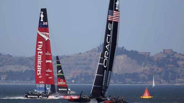 Emirates Team New Zealand, left, sails against Oracle Team USA during Race 17.