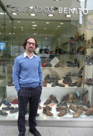 Well connected: Angel Benito outside his shoe shop.