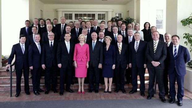 Governor-General Quentin Bryce poses for photos with Prime Minister Tony Abbott and his new ministry after the ...