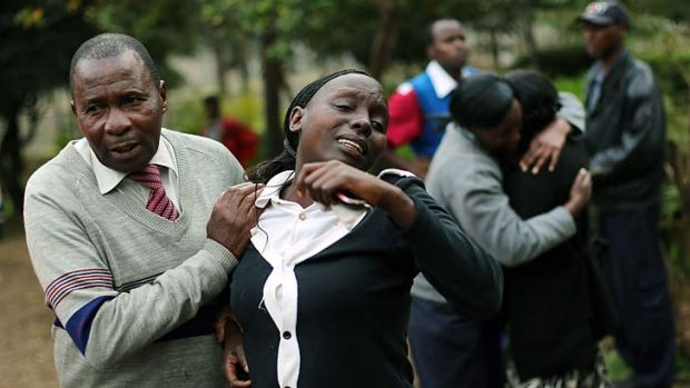 Grieving: Relatives of Johnny Mutinda Musango, 48, a victim of the siege, leave the city morgue in Nairobi after ...