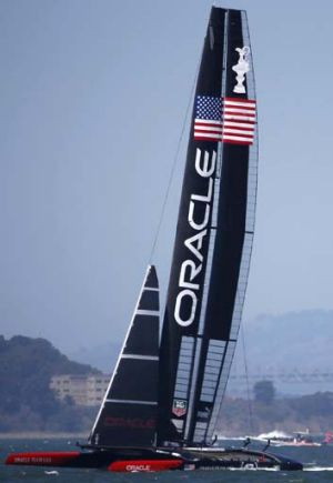 On the cusp of victory: Team Oracle USA during Race 11 of the 34th America's Cup yacht sailing race in San Francisco.